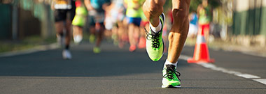 Marathon runner leading race in high performance shoes with great midsoles