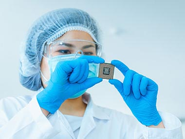 Electronics engineer examining CPU
