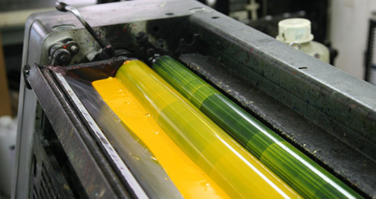 Yellow ink in a one color printing press