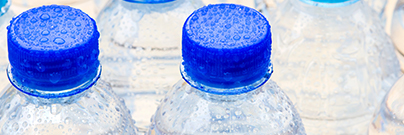 Plastic water bottles with blue caps