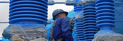 Worker applying High Voltage Insulator Coating (HVIC) to Iberdrola Rocomora substation