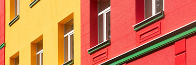 Brightly colored building with green cornice