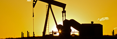 Oil pumpjack in sunset