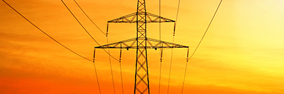 Electrical power transmission with tower at sunset