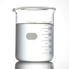 Laboratory beaker with clear liquid on a white background